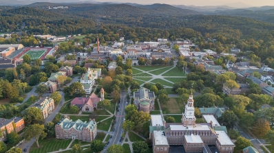An aerial view of the Dartmouth campus, including Baker Tower, Baker-Berry Library, Carson Hall, and the Dartmouth Green.